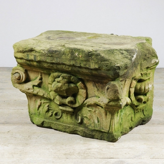 Antique hand carved sandstone corbel with acanthus leaf and urn decorations to each side.