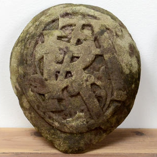 Early carved armorial initial stones