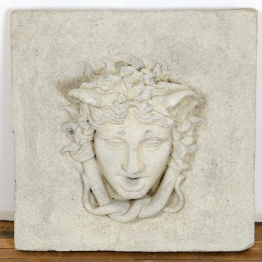 Reclaimed composite stone fountain head depicting a faun